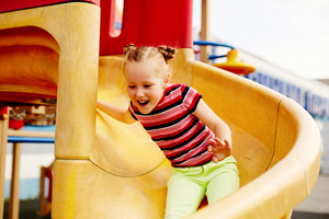 Image Of Ecstatic Girl Having Fun On Playground