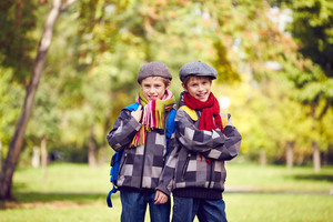 Portrait Of Twin Boys In Casual Looking At Camera In Park