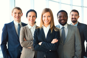 Group Of Business Partners Looking At Camera With Smiles