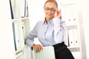Portrait Of Elegant Businesswoman Looking At Camera In Office