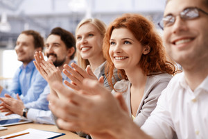 Group Of Business Partners Applauding At Conference