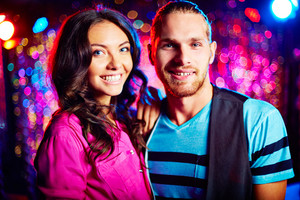 Portrait Of Young Smiling Couple At Party