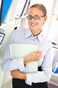 Vertical Image Of A Smiling Businesswoman Holding A Folder
