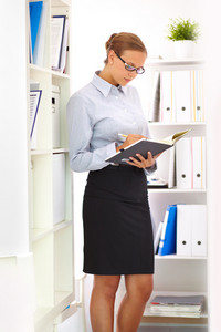 Vertical Image Of A Busy Business Lady Working In Archive