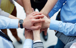 Businesspeople Joining Their Hands In The Sign Of Unity