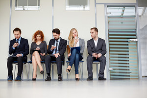 Group Of Businesspeople Busy With Their Smartphones