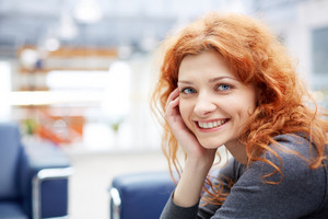 Portrait Of Young Smiling Businesswoman Looking At Camera