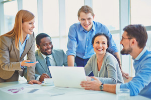 Group Of Business Partners Explaining Ideas At Meeting In Office