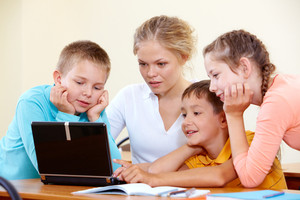 Smart Schoolchildren And Teacher Working With Laptop