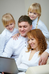 Image Of Friendly Family Watching Film By Laptop