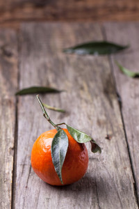 Tangerine With Leaves On Wooden Background