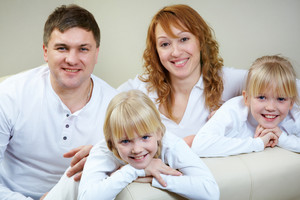 Portrait Of Happy Family Of Four Looking At Camera