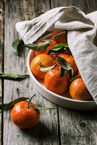Tangerines With Leaves On Wooden Background