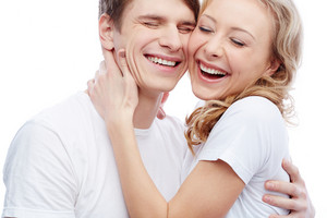 Portrait Of Amorous Young Couple Touching By Faces And Laughing