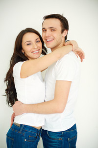 Portrait Of Amorous Young Woman And Man In Casual Clothes Embracing
