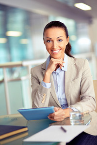 Portrait Of Confident Employee With Touchpad Looking At Camera
