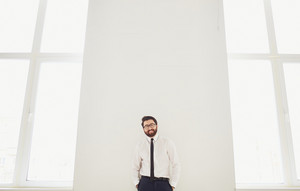 Portrait Of Elegant Businessman Looking At Camera Indoors