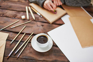 Image Of Cup Of Coffee And Objects For Hand Drawing On Background Of Male Hands Over Notepad