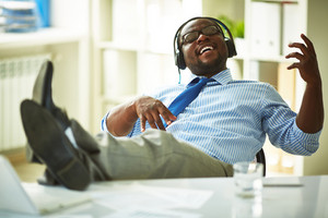 Image Of Young Businessman Taking Pleasure In Listening To His Favourite Music In Office