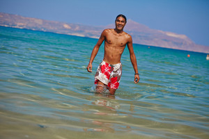 Young Shirtless Man Standing In Water