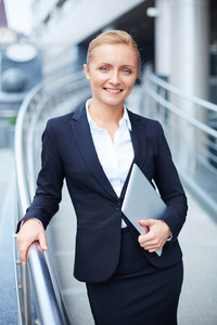 Portrait Of Elegant Businesswoman With Touchpad