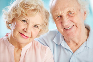Close-up Portrait Of A Charming Elder Couple Looking At The Viewer With A Smile