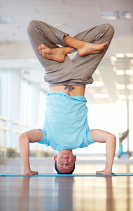 Man Showing Headstand In Lotus Position