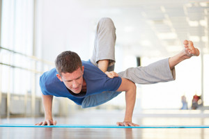 Man Practicing Complicated Handstand