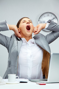 Tired Office Manager Stretching Herself And Yawning