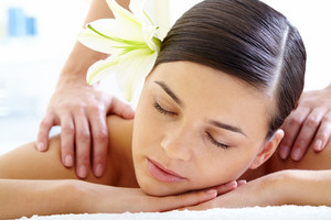 Portrait Of Calm Female During Luxurious Procedure Of Massage