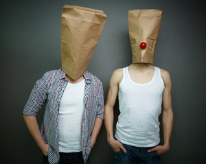 Two Guys Standing In Front Of Camera In Paper Bags Celebrating Fool