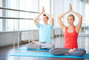 Two People Mastering Yoga Exercises
