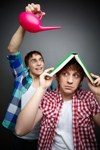 Freaky Guy Pouring Water Over His Friend Hiding Under A Book