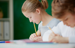 Image Of Cute Girl With Pencil Thinking Of What To Draw