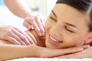 Smiling Female Enjoying Massage In Spa Salon