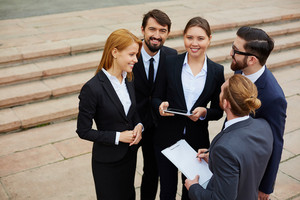 Group Of Business People Having Meeting Outside