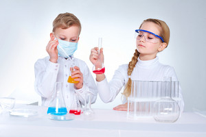Young Scientists Mixing Chemical Substances In The Lad