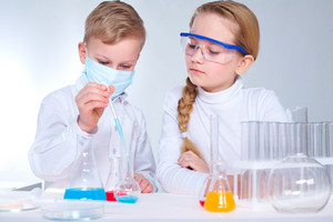 Two Children Making Chemical Experiments