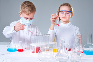 Team Of Young Prodigies Conducting Scientific Experiments