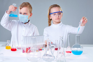 Studio-shot Of A Team Of Young Researchers Experimenting With Substances