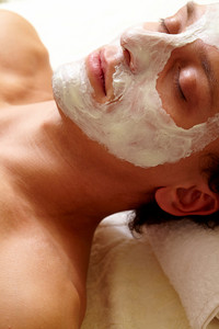 Young Man Having Pore Cleaning Mask On His Face