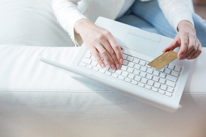 Hands Of Female Sitting At The Laptop With A Credit Card