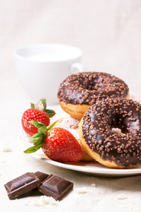 Chocolate Donuts With Fresh Strawberries