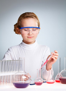 Vertical Shot Of A Charming Scientific Worker Mixing Reagents