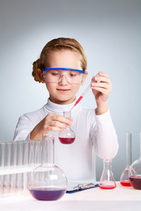 Female Pupil Mixing Substances In The School Lab