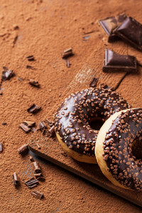 Donuts With Cocoa Powder And Chocolate