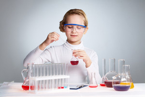 Little Girl Playing Scientist Pipetting Fluid Into A Flask