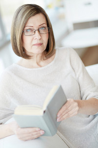 Portrait Of Woman Wearing Eyeglasses With A Book