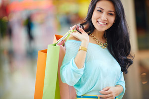 Portrait Of A Girl Holding Colorful Shopping Bags