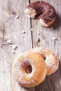 Donuts Over Wooden Background